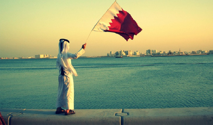 Qatari KId and flag