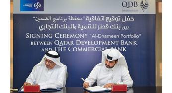 Abdulaziz Bin Nasser Al Khalifa, CEO of Qatar Development Bank (R) and Mr. Abdulla Saleh Al Raisi, CEO of Commercial Bank (L)